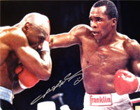 Sugar Ray Leonard Autographed 16x20 Photo Punching Marvelous Marvin Hagler