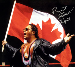 "Bret ""Hitman"" Hart Autographed 16x20 Photo With The Canadian Flag"