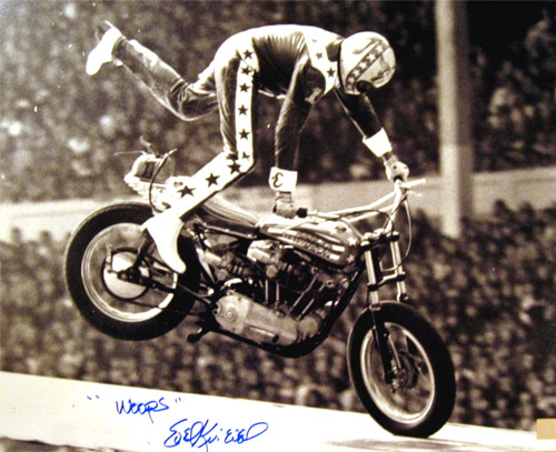"Evel Knievel Autographed 16x20 Photo Wembley Crash With ""WOOPS"" Inscription"