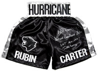 "Not Guilty! Rubin ""Hurricane"" Carter & Not Guilty! John Artis Autographed Black Boxing Trunks"